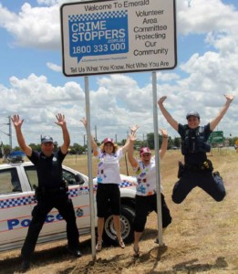 Emerald Volunteer Area Committee Jump for Joy under Road Sign